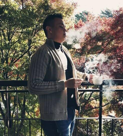 [Image: Brendan, in a dapper suit drinking tea