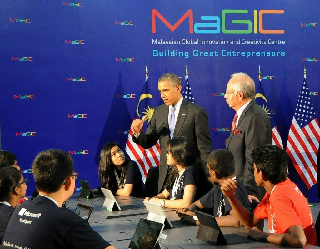 US President Barack Obama (L, standing) talks with a group of students while Malaysian Prime Minister Najib Razak (R) looks on during a visit to the Malaysian Global Innovation and Creativity Centre (MaGIC) in Cyberjaya, outside Kuala Lumpur, Malaysia, 27 April 2014. Obama, the first US president to visit the predominantly Islamic country of Malaysia since 1966, is on the third leg of his Asian tour that included Japan and South Korea.